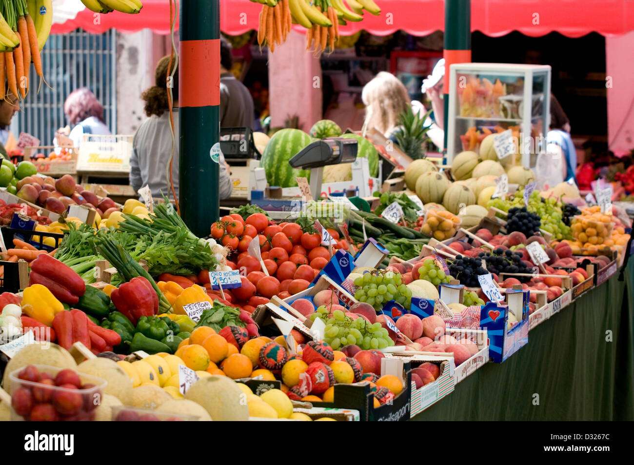 Fruit, vegetables, and customers at the Mercato di Rialto, San Polo, Venice, Italy. Stock Photo