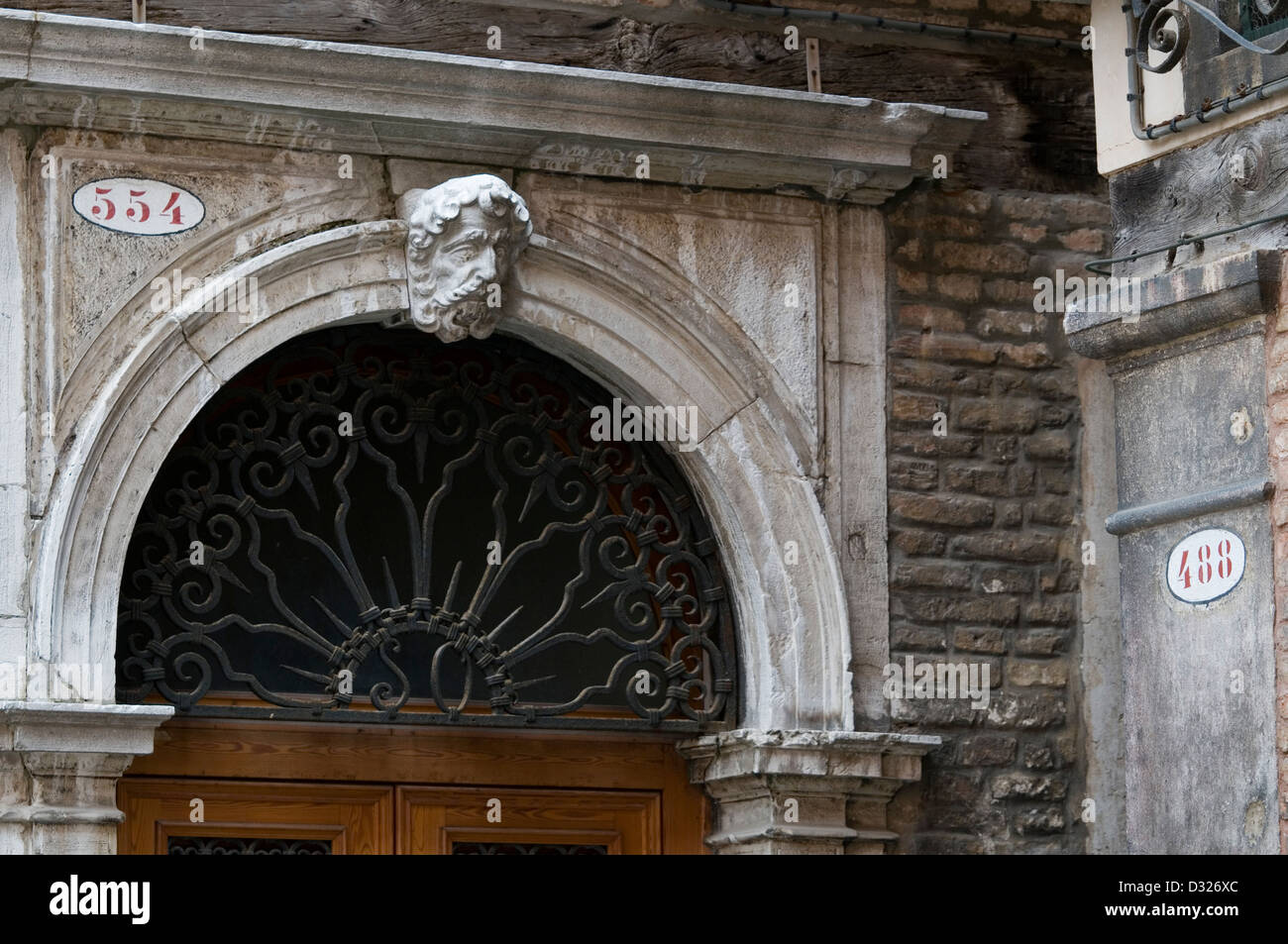 Doorway and house numbers in Campo Di Rialto Nuovo, San Polo, Venice, Italy. - Stock Image