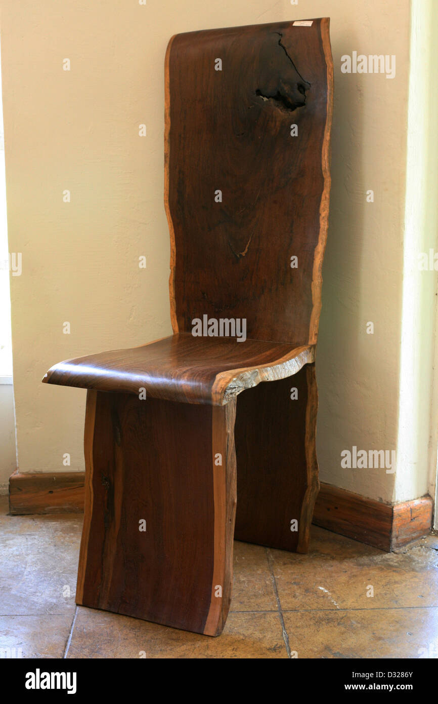 Wooden chair crafted with an organic feel and design in Malawi - Stock Image
