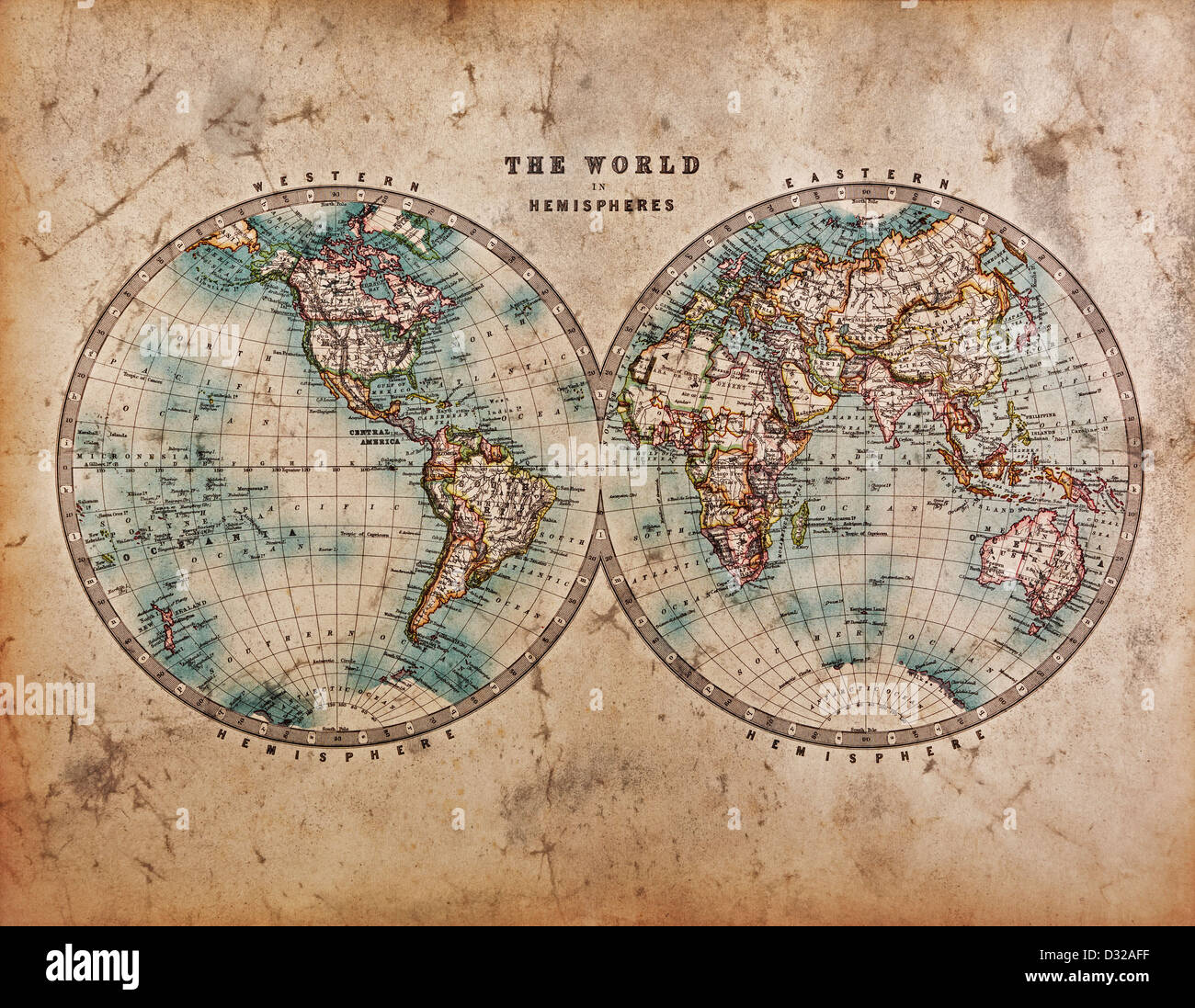 A genuine old stained World map dated from the mid 1800's showing Western and Eastern Hemispheres with hand - Stock Image