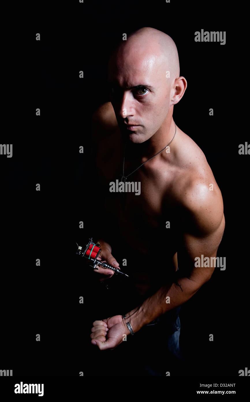 Skinny bald man