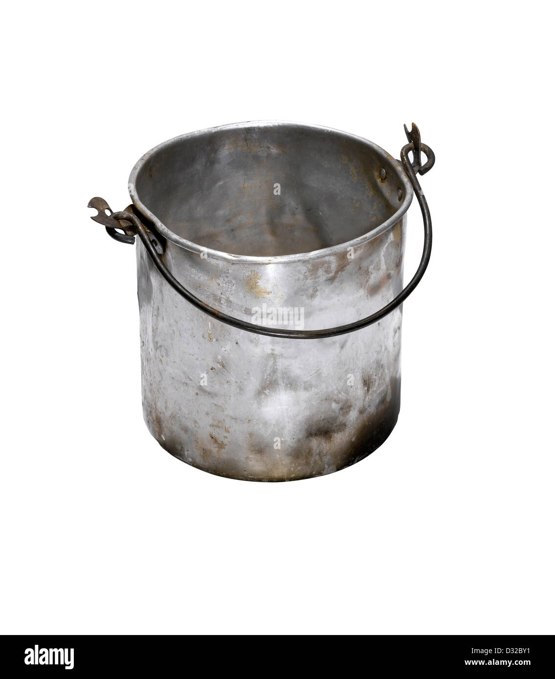 An old battered silver bucket with the handle down - Stock Image