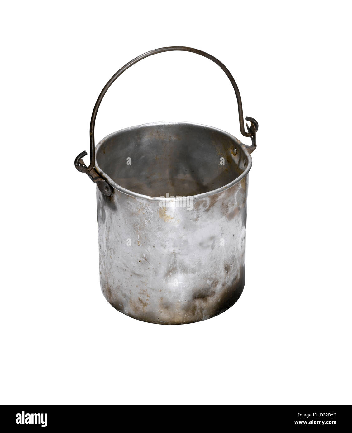 An old battered silver bucket with the handle up. - Stock Image