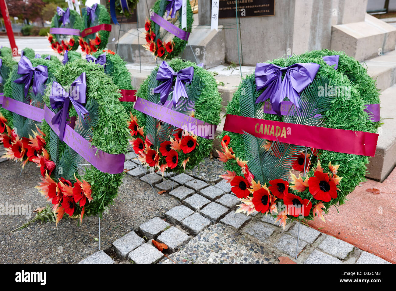 poppy wreaths laid at a war memorial in canada Vancouver BC Canada - Stock Image
