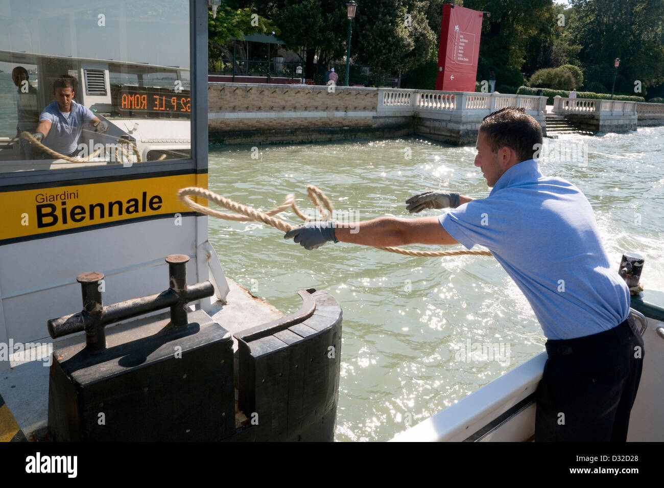A vaporetto ties-up at the Biennale stop, Castello, Venice, Italy. - Stock Image