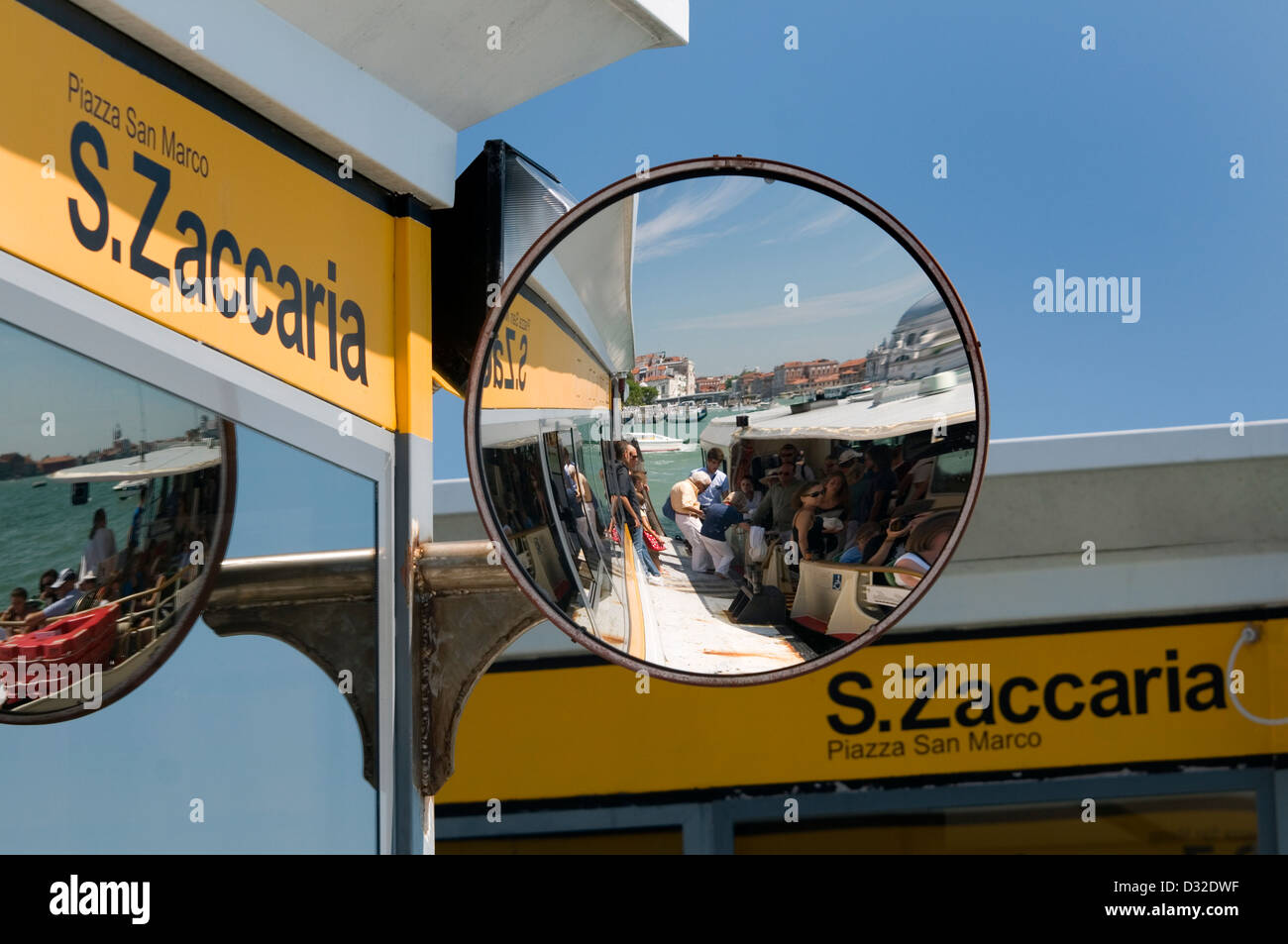 A vaporetto (water-bus) at the San Zaccaria stop, Castello, Venice, Italy. - Stock Image