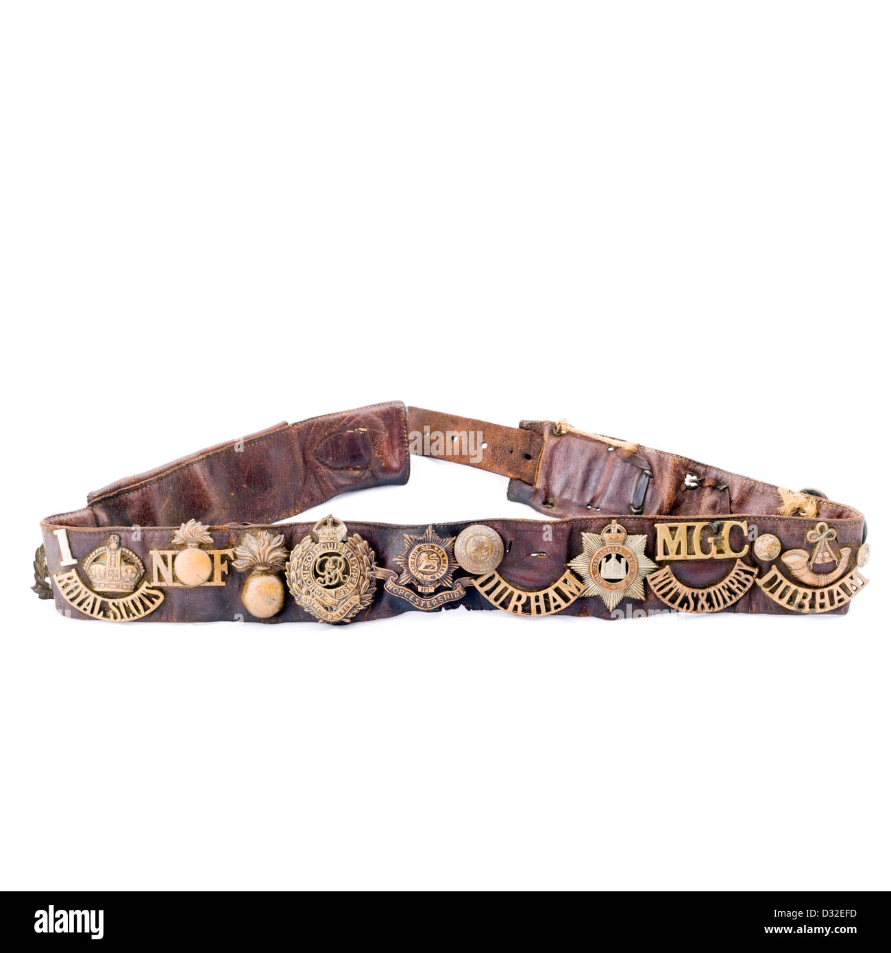 Image of a Army World War 1 belt with many awarded badges and medals attached to it - Stock Image