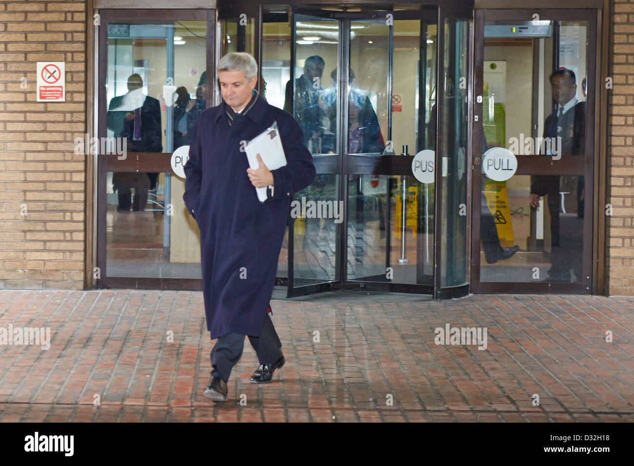 Former MP Chris Huhne (pictured) leaves Southwark Crown Court after pleading not guilty to perverting the course - Stock Image