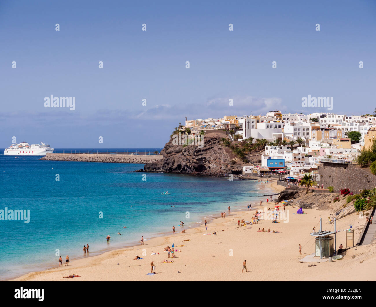 A ferry boat arrives at the port of Morro Jable, Fuerteventura, Canary Islands. - Stock Image