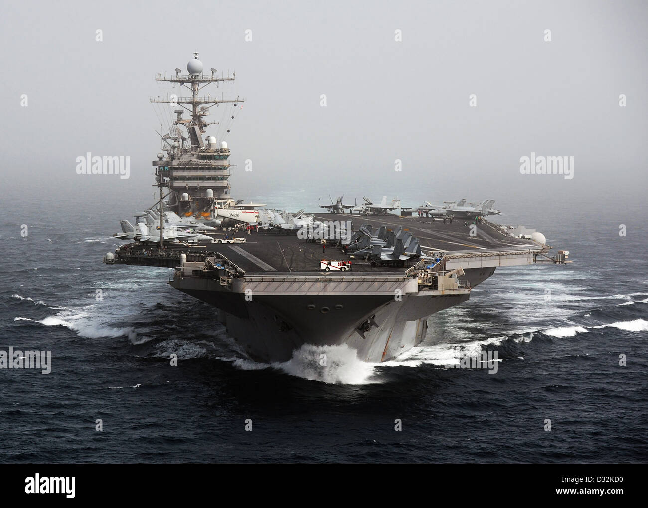 The aircraft carrier USS Abraham Lincoln transits the Arabian Sea. - Stock Image