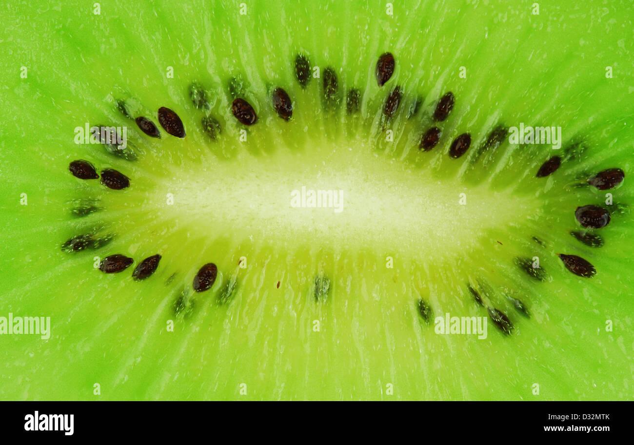 Kiwi fruit macro shot - fresh green background - Stock Image