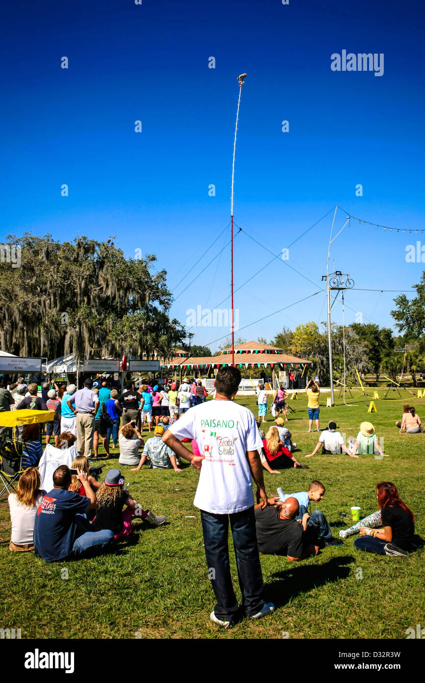 Carla Wallenda on top of a 100ft pole performing to the crowd below at the Italian Fiesta Sarasota - Stock Image