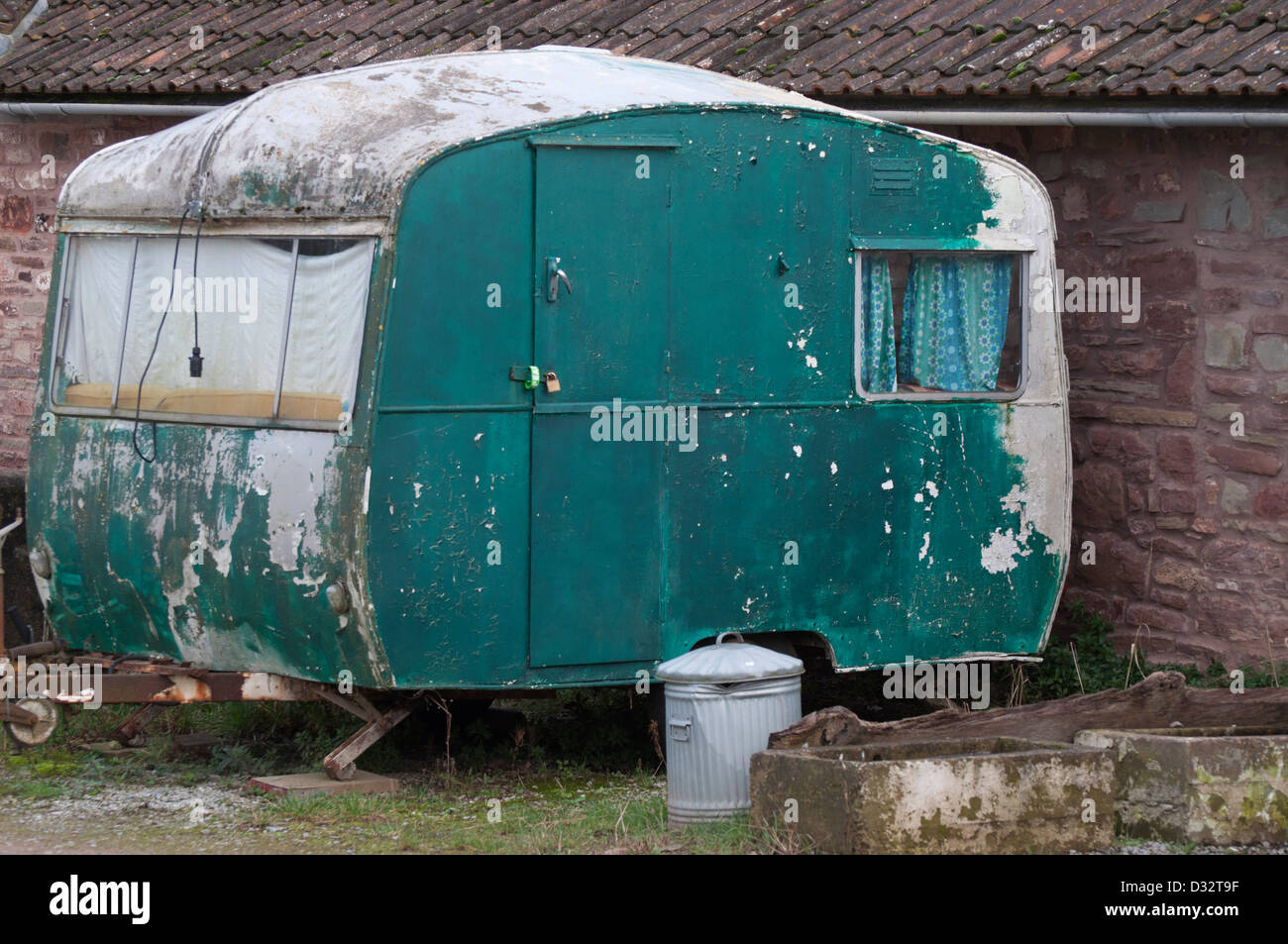 old caravan, abandoned, derelict, decrepit, peeling paintwork. disused, Stock Photo