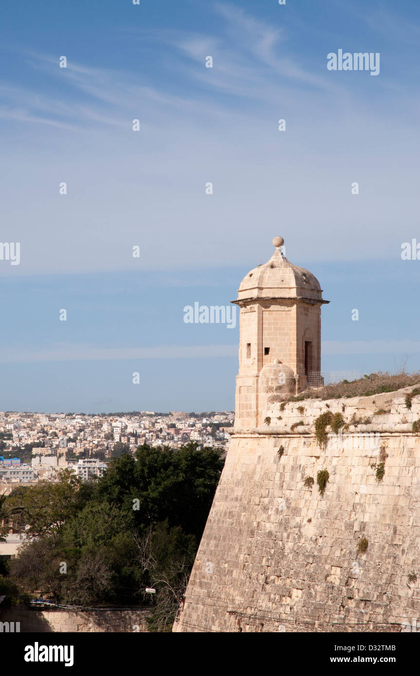 Valetta, Malta, part of massive stone city wall, watchtower, fortifications, protection,sunny, blue sky, battlements - Stock Image