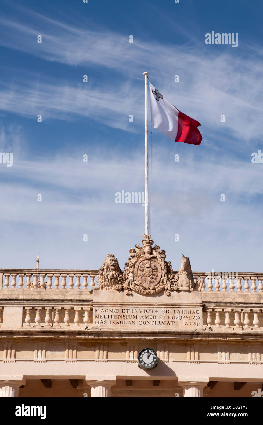 Valletta, Malta, Auberge, Central Valletta, public building, Maltese flag flying on flagpole on top of building - Stock Image