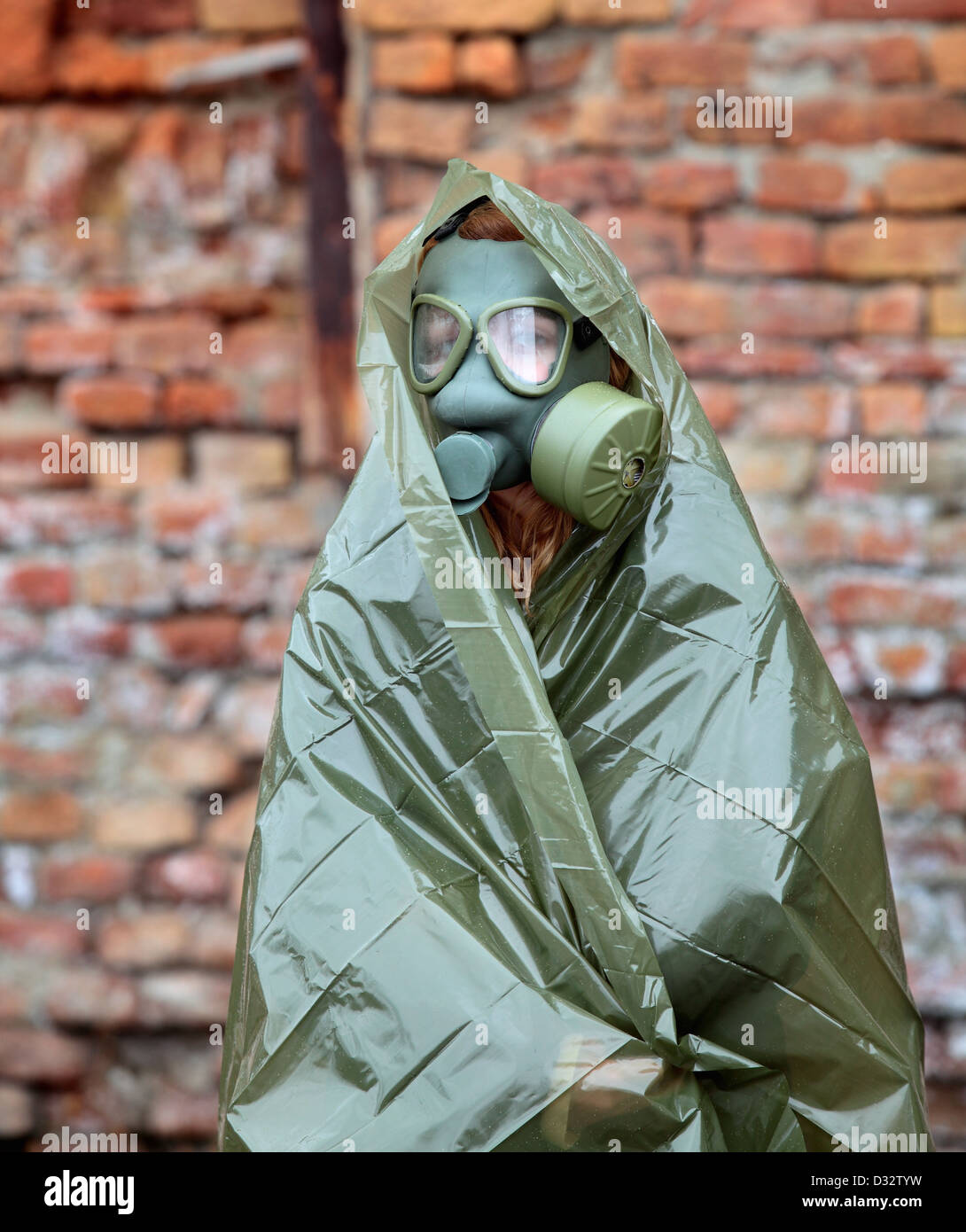 Protective wear and mask for nuclear, bio and chemical protection - Stock Image