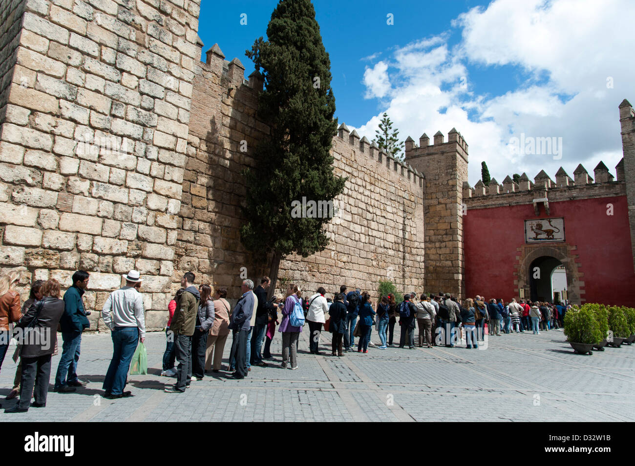 Long line of tourists queuing to enter the Alcazar of Seville, Andalucia, Spain Stock Photo