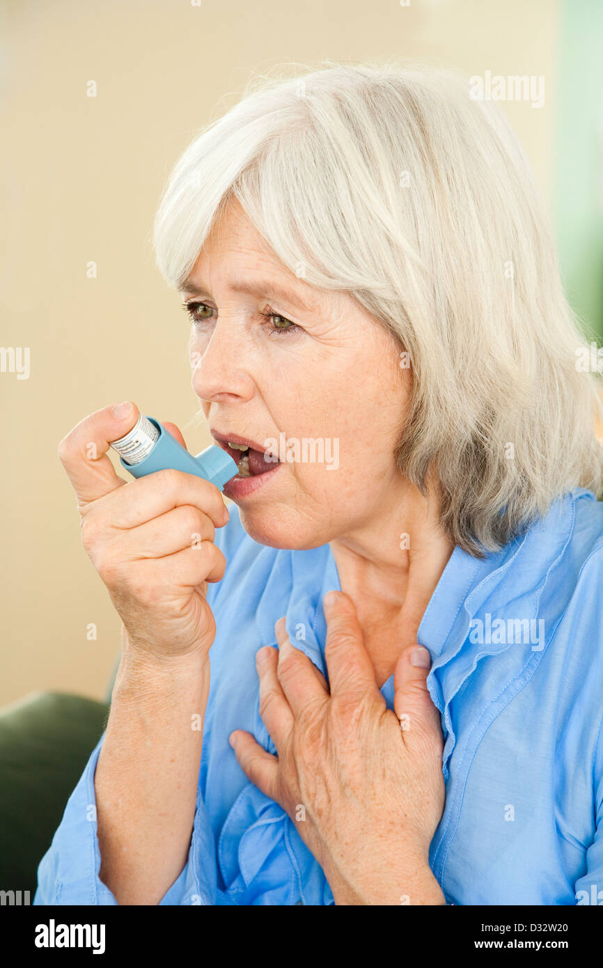 Elderly lady suffering from asthma Stock Photo