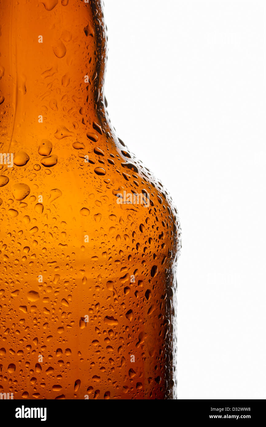 Water droplets on chilled transparent brown beer bottle - Stock Image