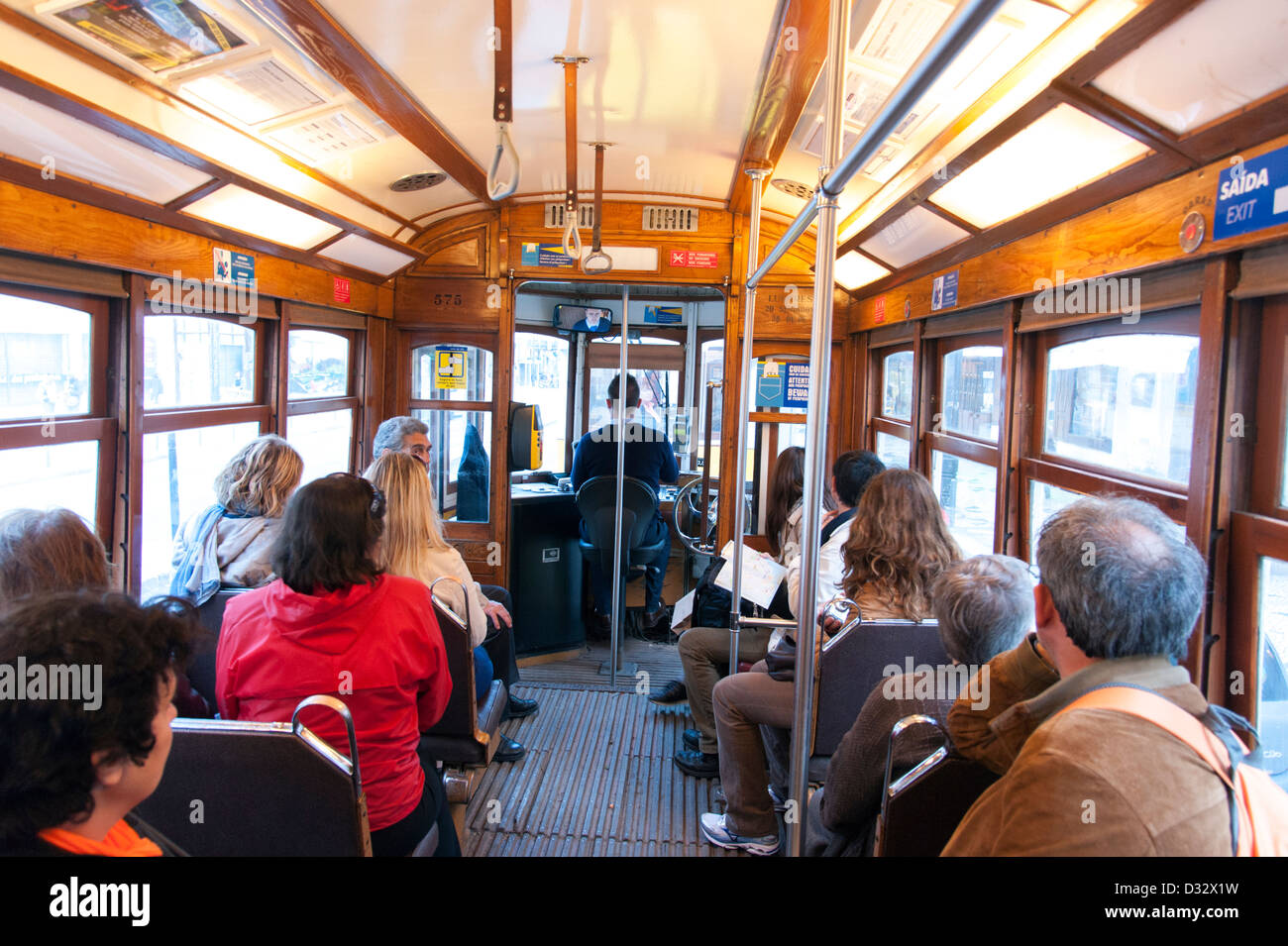 People riding a tram, Lisbon, Portugal - Stock Image