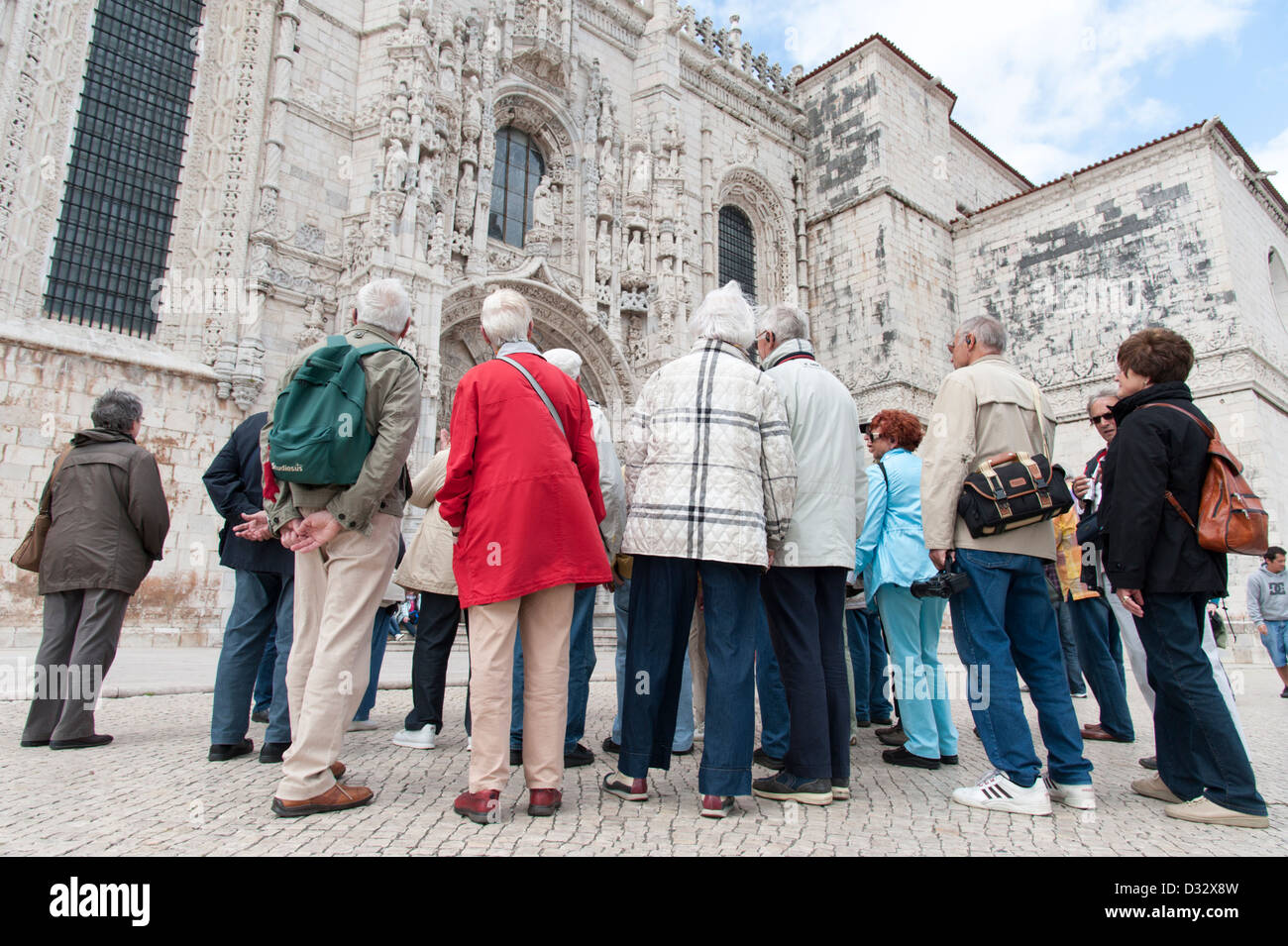 Group of elderly German tourists on a guided tour visiting the Jeronimos Monastery, Lisbon, Portugal - Stock Image