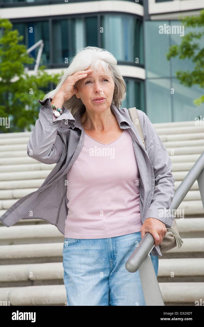 Elderly lady feeling giddy - Stock Image