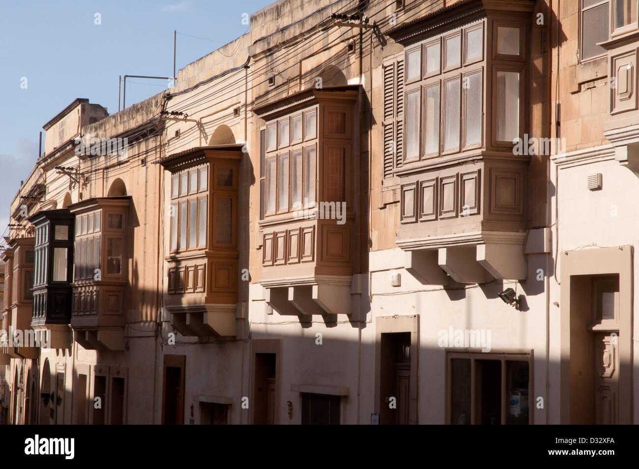 Gozo, street scene,  peaceful, no people, no traffic, stone walls, stone slab , balcony, - Stock Image