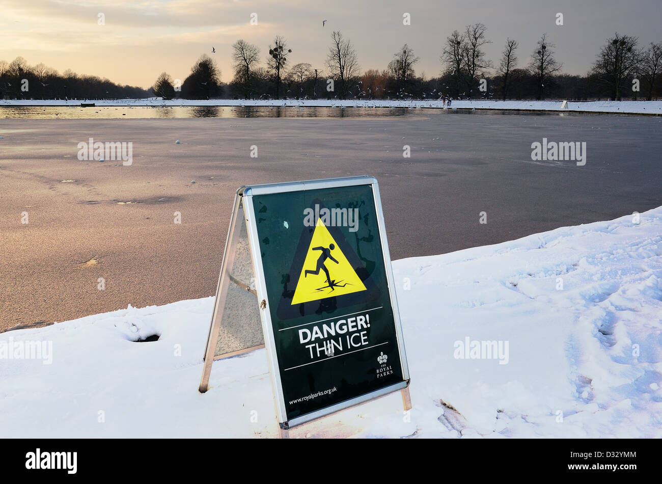 Warning sign 'Danger Thin Ice' in Bushey Park London - Stock Image