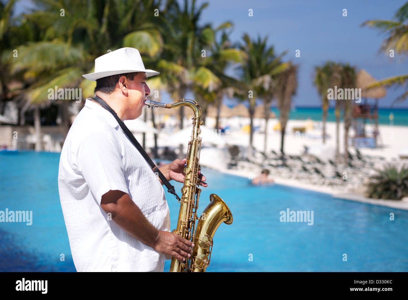 Man playing Saxophone at beach - Stock Image