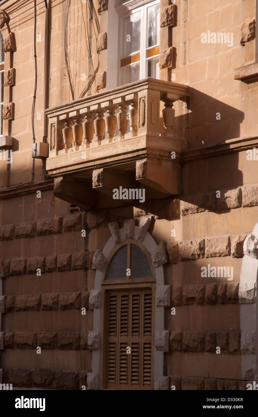Sliema, street scene,  peaceful, no people, no traffic, stone walls, stone slab , balcony, - Stock Image
