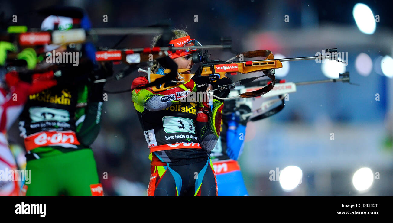 Gabriela Soukalova of Czech Republic, center, competes during the 2x6km + 2x7.5km mixed relay at the Biathlon World - Stock Image