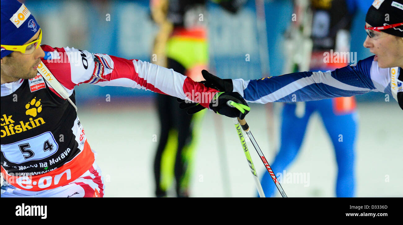 Alexis Boeuf, right, and Martin Fourcade of France compete during the 2x6km + 2x7.5km mixed relay at the Biathlon - Stock Image