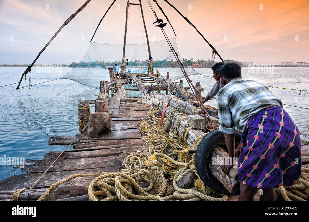 086daea6895 Fishermen operate an old Chinese fishing net in the harbour at Fort Kochi