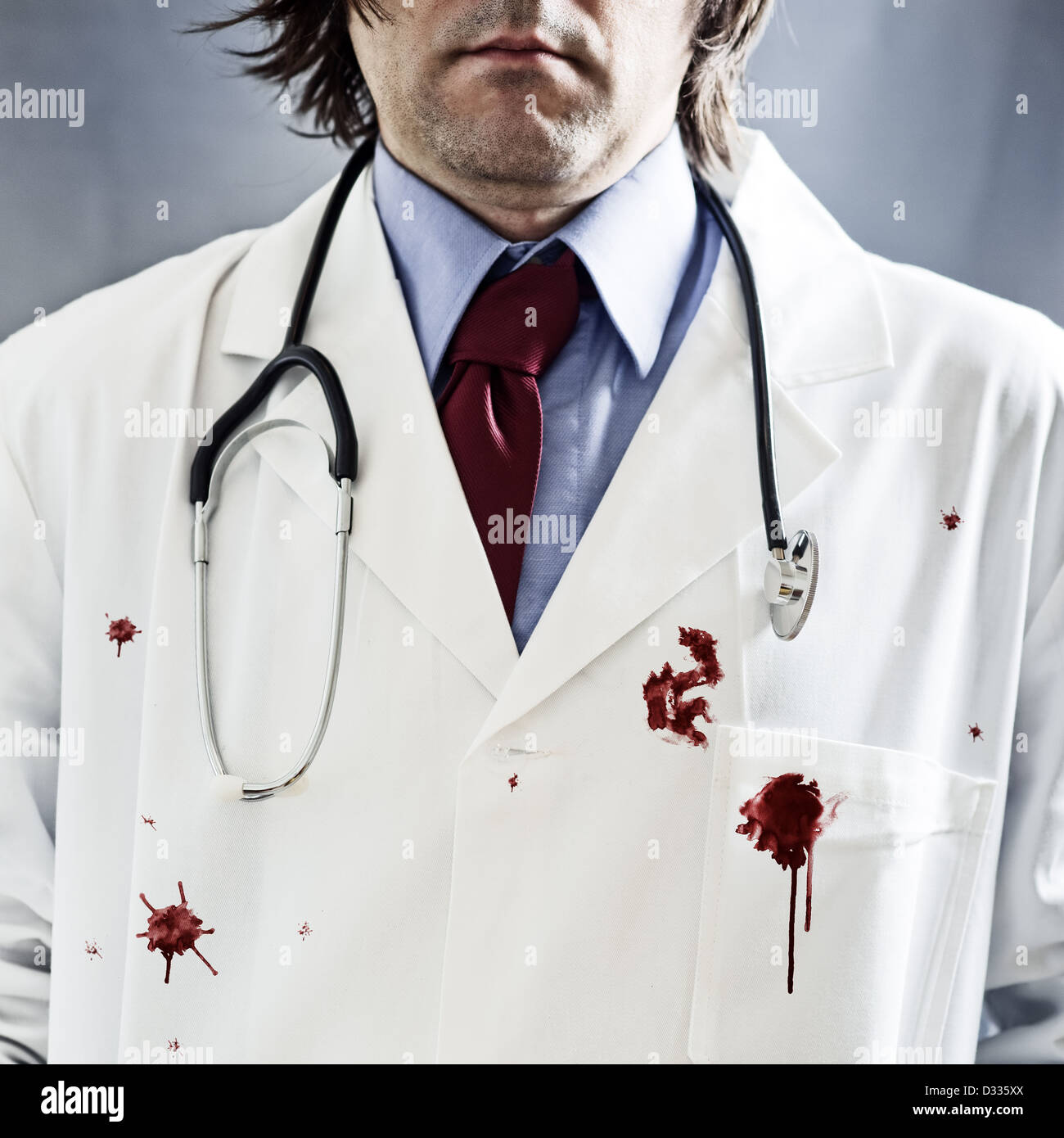 male doctor in bloody white coat. - Stock Image