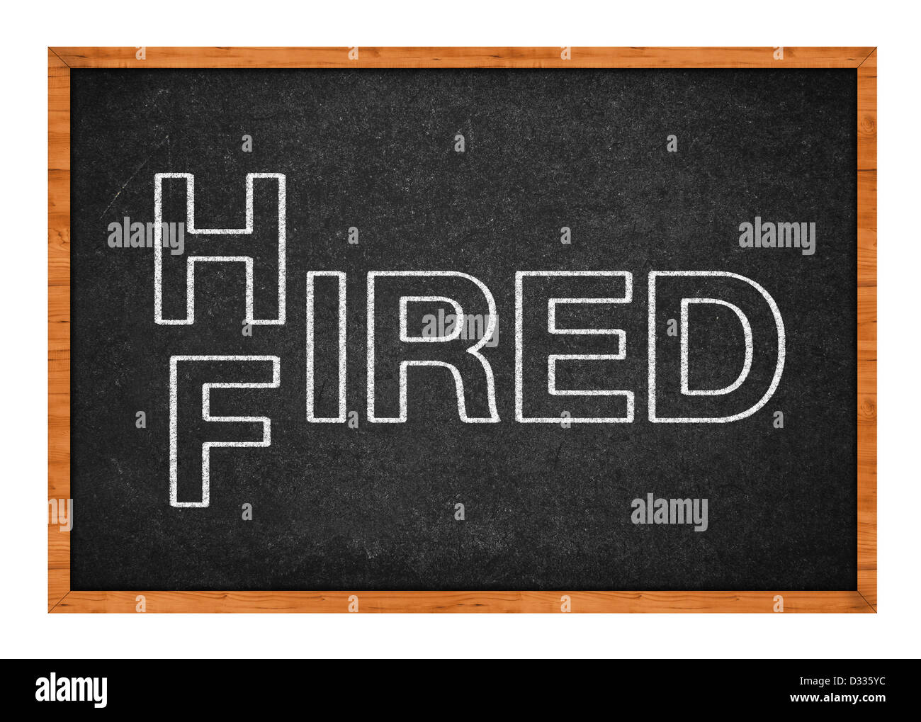 Hired or fired concept, two words handwritten on a chalkboard. - Stock Image