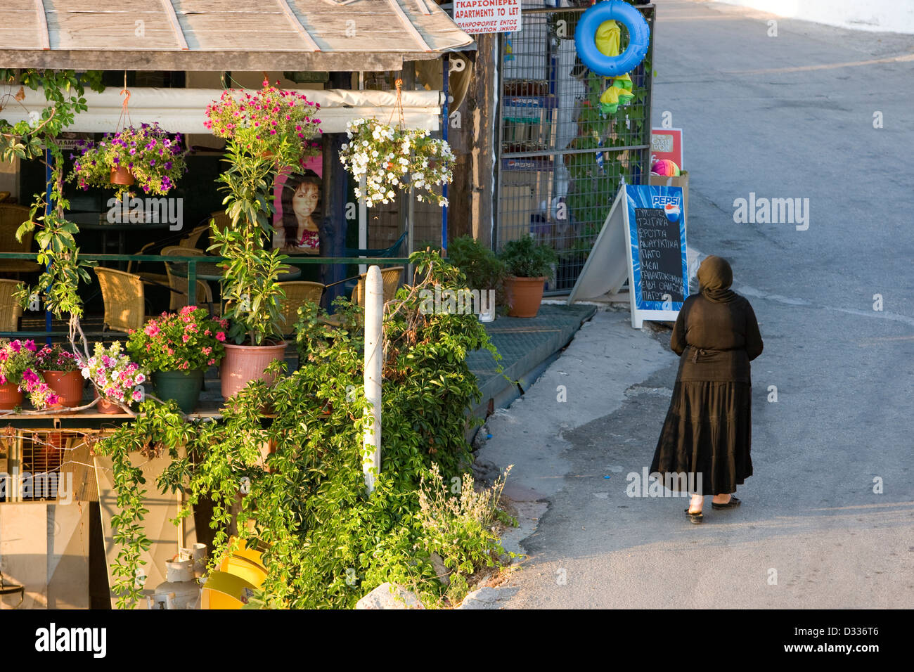 A black-dressed woman in the village of Athani; Lefkada, Ionian islands. Greece. - Stock Image
