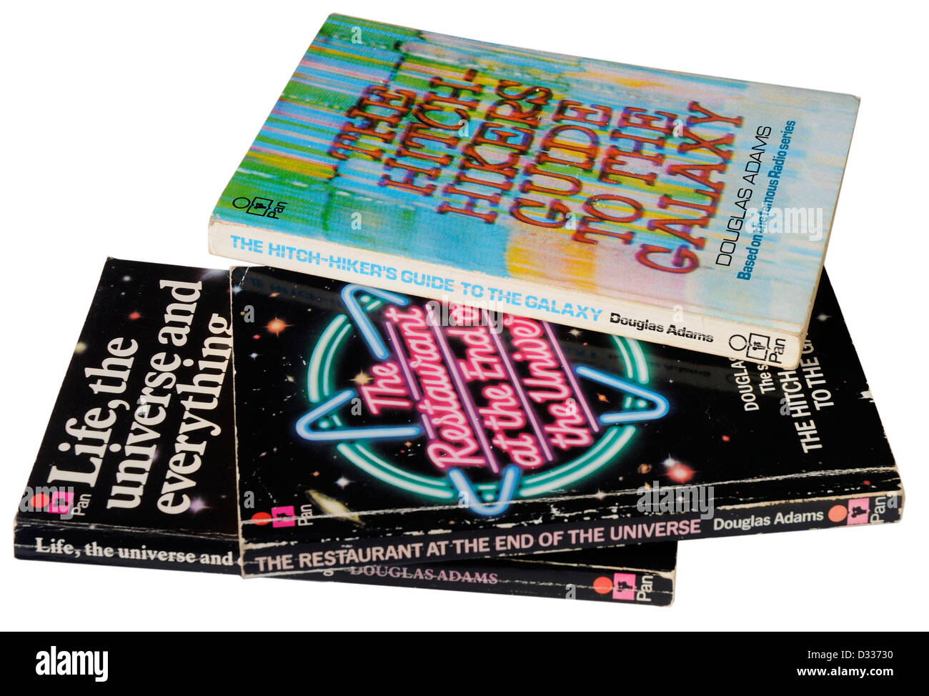 The Hitch Hikers Guide to the Galaxy trilogy by Douglas Adams - Stock Image