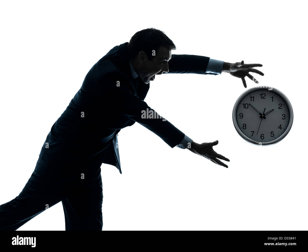 one  businessman running after time in silhouette studio isolated on white background - Stock Image