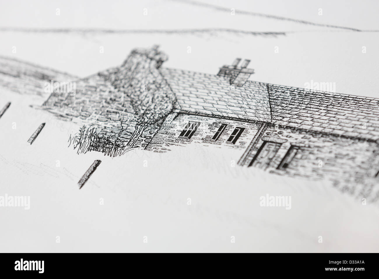 Artist drawing / sketching in studio pen and ink line drawing of old Scottish cottage architecture in Orkney islands. - Stock Image