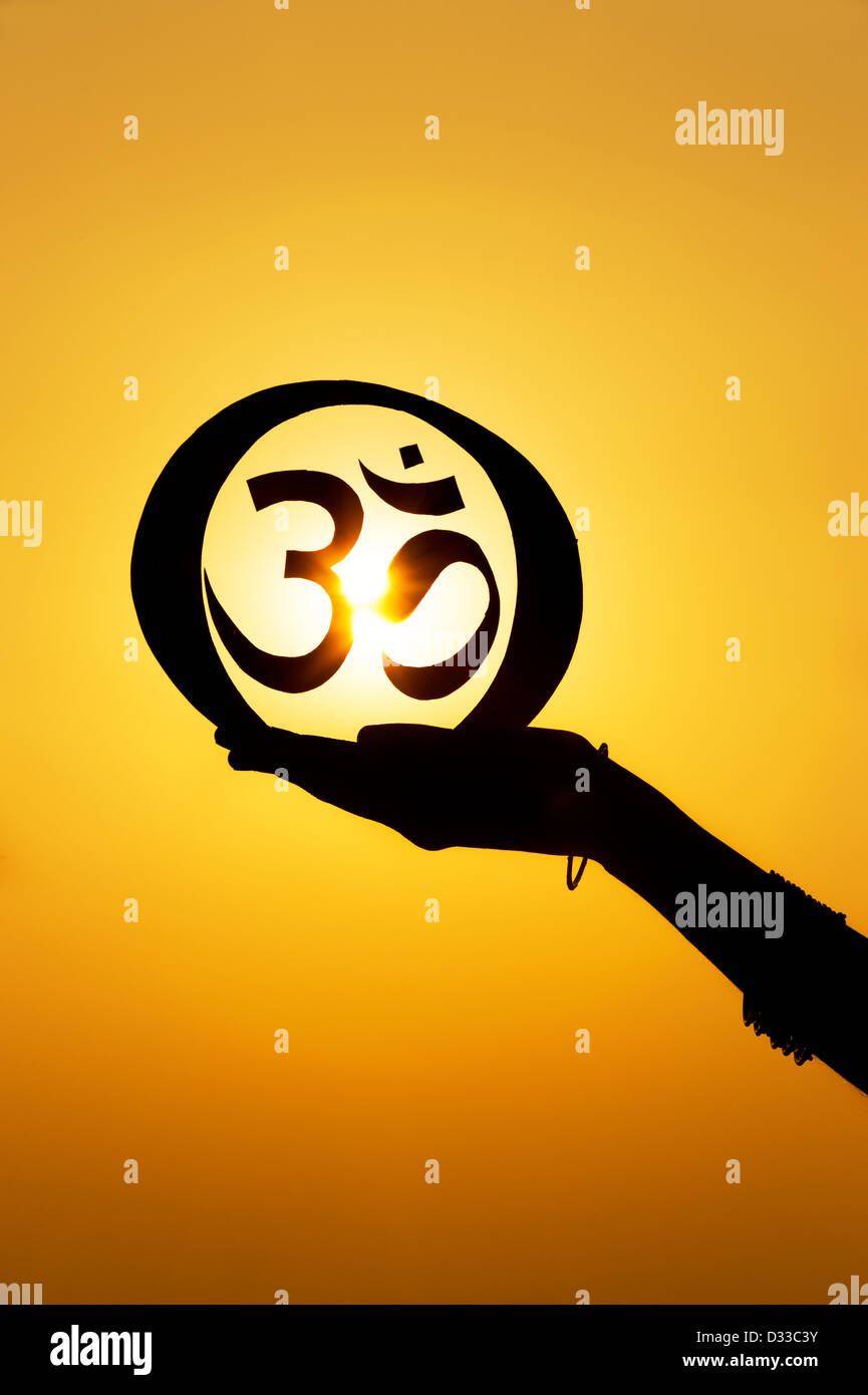 Hand Holding Hindu Om Aum Symbol At Sunset India Silhouette