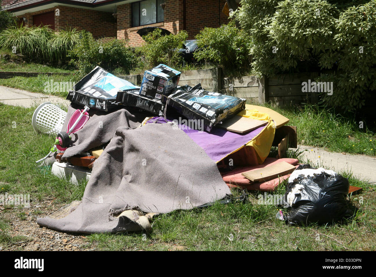 Junk thrown out for recycling in Australia - Stock Image