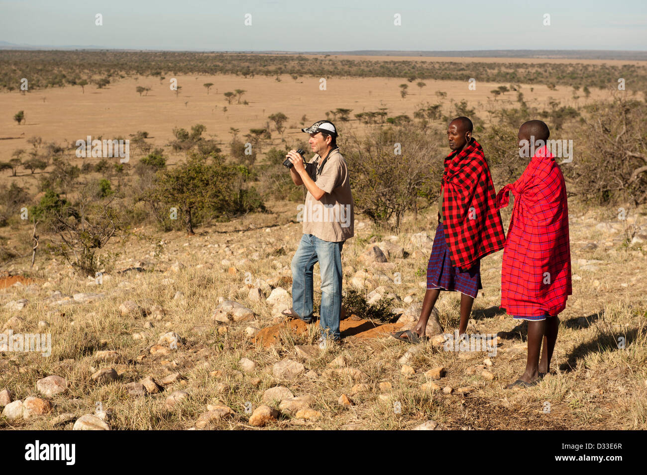 Walking safari with Masai guides, Maasai Mara National Reserve, Kenya - Stock Image