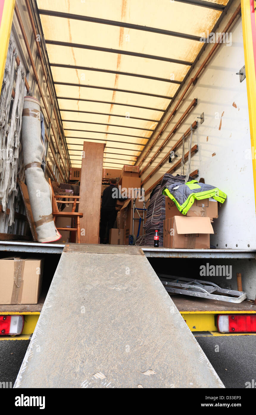 Looking into the back of a removal van part way through being filled for a house move. Stock Photo