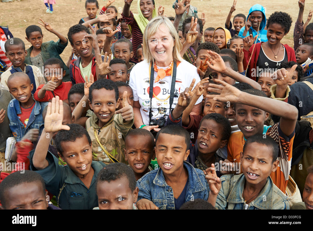"""Margaret D. Lowman or """"Canopy Meg"""" poses with a group of children in Bahir Dar Stock Photo"""