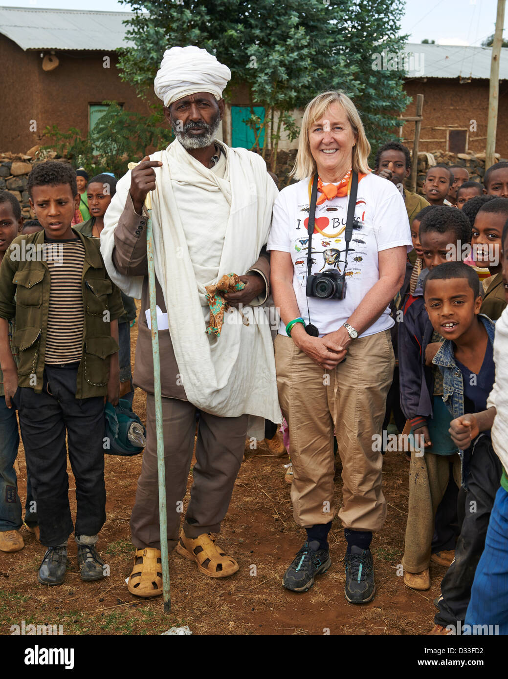 "Margaret D. Lowman or ""Canopy Meg"" poses with a group of children and a priest in Bahir Dar Stock Photo"