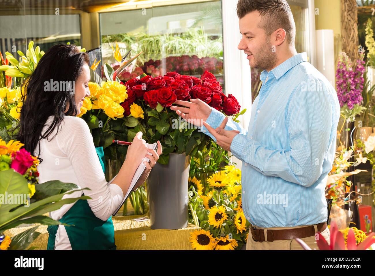 Man customer ordering flowers bouquet flower shop florist stock man customer ordering flowers bouquet flower shop florist izmirmasajfo Image collections