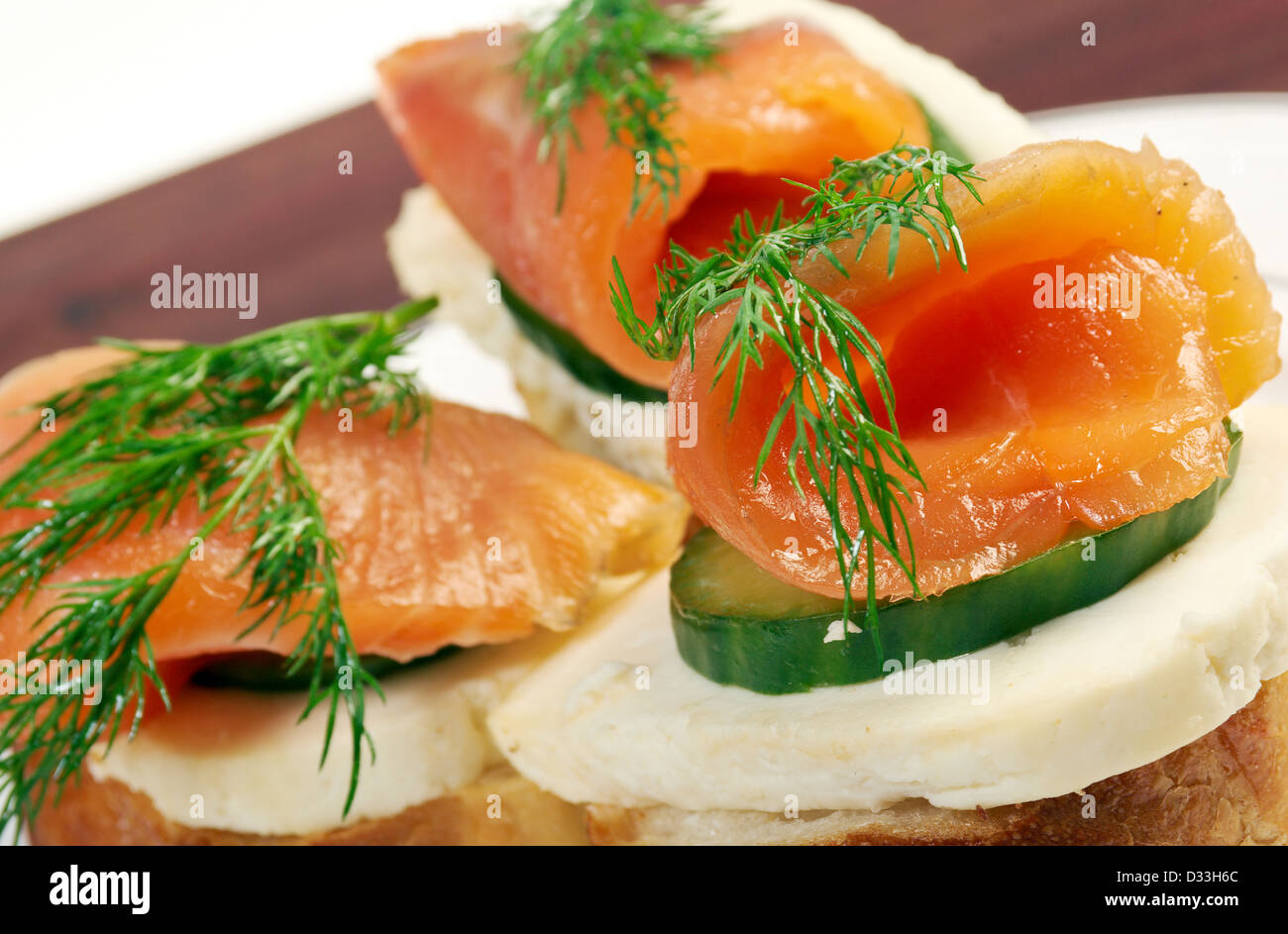 Canapes with smoked salmon,cheese and cucumber. close up  - Stock Image