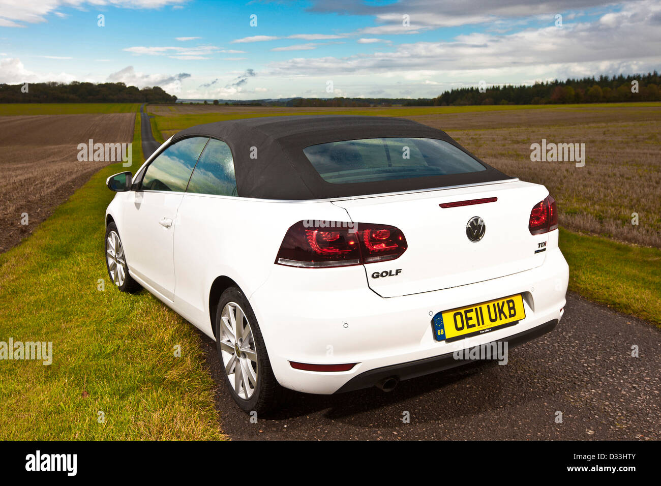 Volkswagen Golf 1.6 TDI convertible on country lane, Winchester, UK, 25 10 2010 - Stock Image