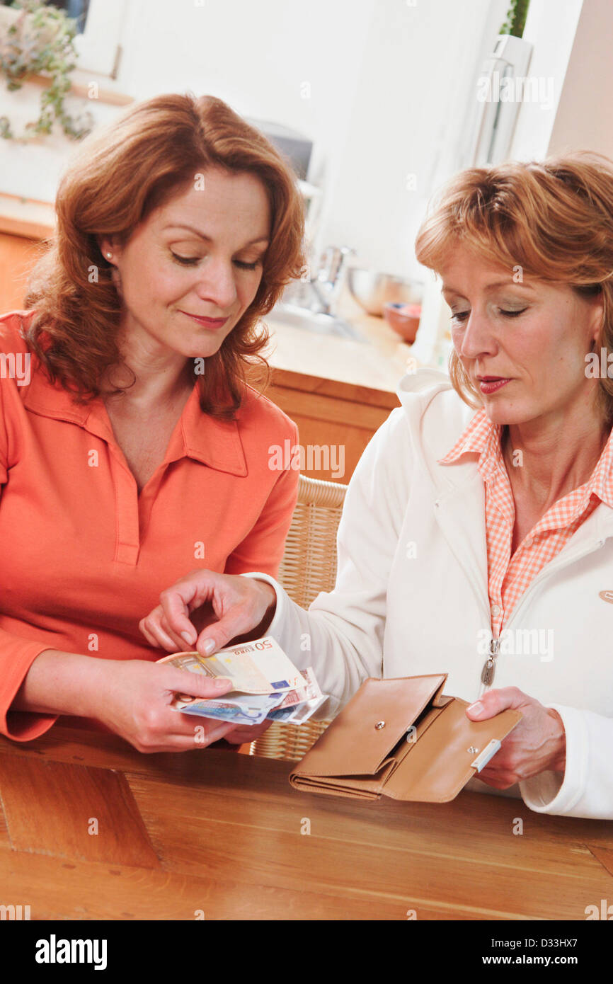 Woman borrowing money - Stock Image