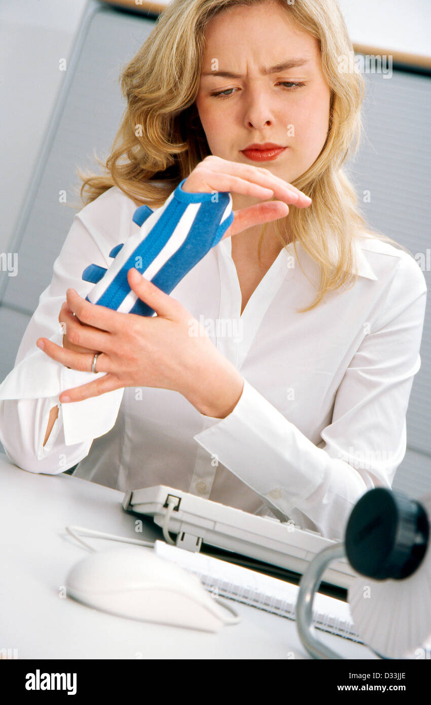 Young office employee suffering from carpal tunnel syndrome Stock Photo